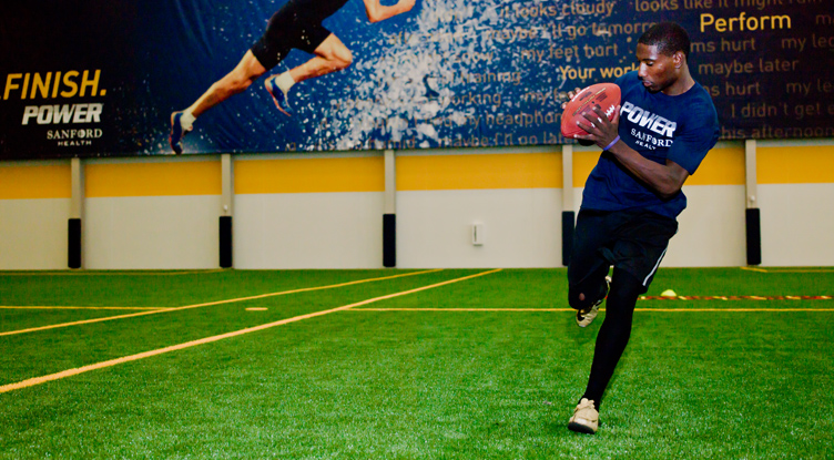 Sanford POWER Riggs Football Academy player catching pass