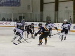 Alex Secord (#20) carries the puck with Jones (88), Desjardins (17) and Robert (19) on offense