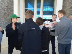 Steven McNamara, Jake Ashlock and Julian Gonzalez move a basket toward a waiting truck
