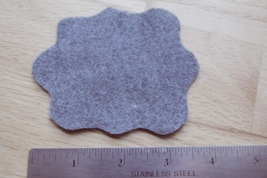 Making felt flowers with grey felt.