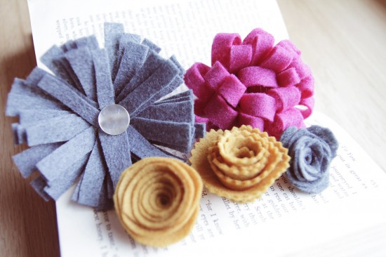 All five techniques of felt flowers being displayed on a table.