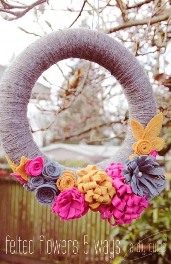 Felt flower wreath hanging in backyard