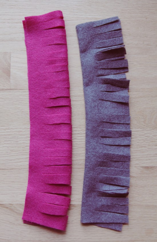 Strips of felt with slits at bottom to make felt flowers.