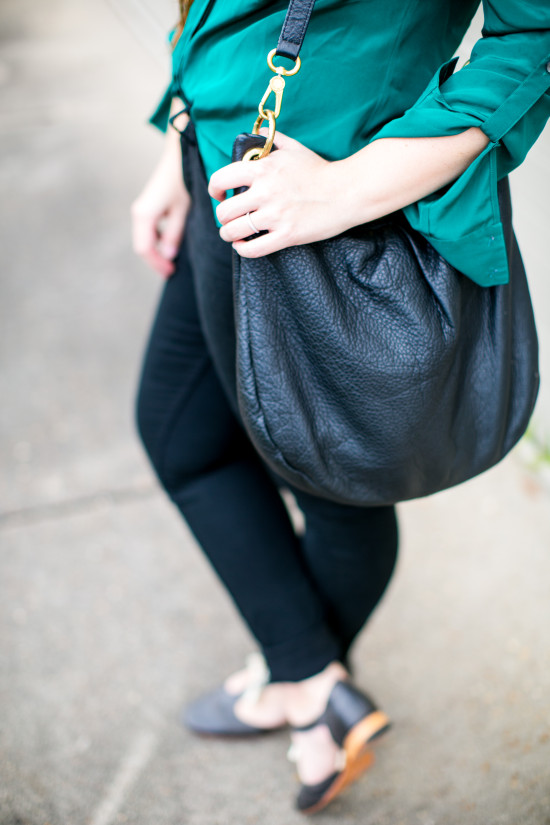 leather bag. teal shirt.