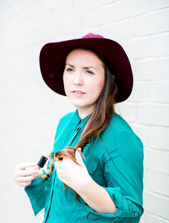 burgundy hat. teal shirt.
