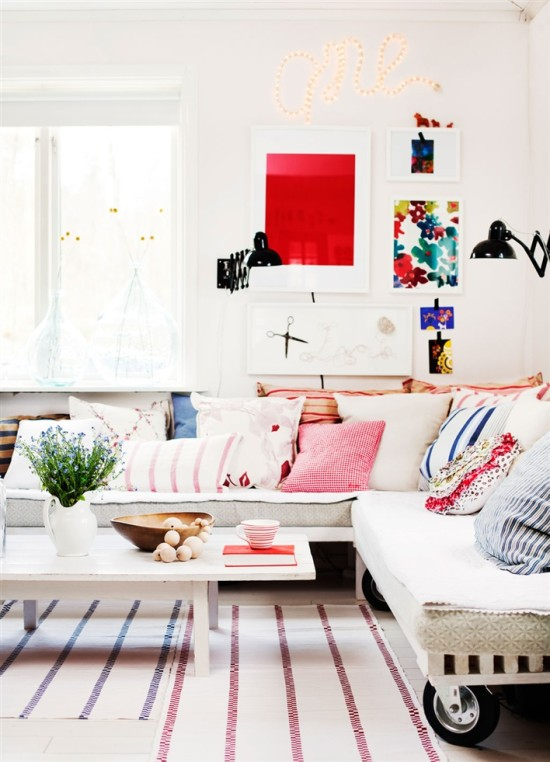 love this white living room with colorful accents and accessories