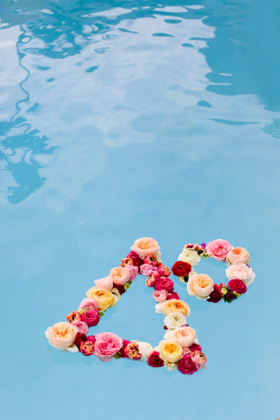 flower wreaths floating in a pool