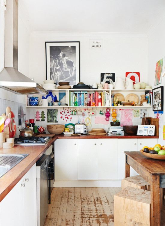 a white kitchen with colorful accessories