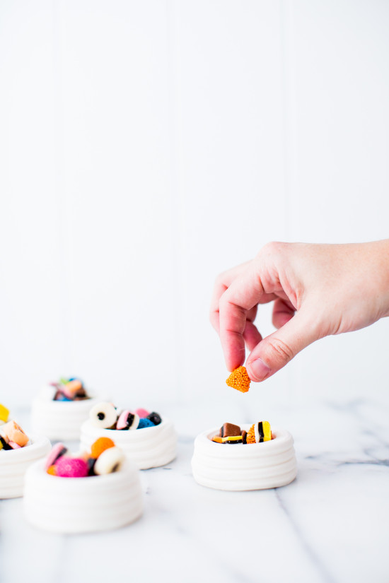 Licorice candies in tiny, edible meringue cups