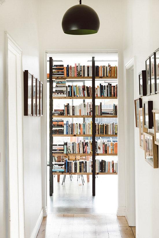 giant bookshelf down the hallway