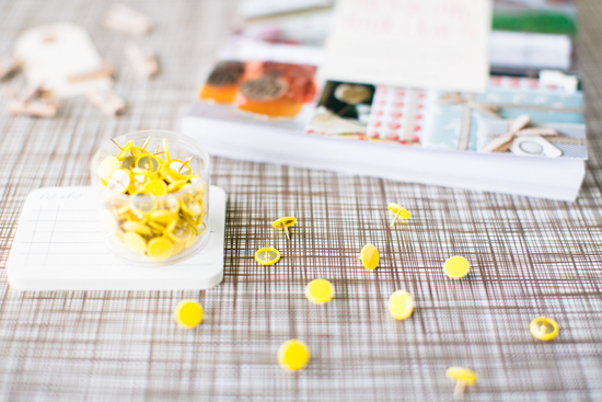 Yellow thumbtacks around the office