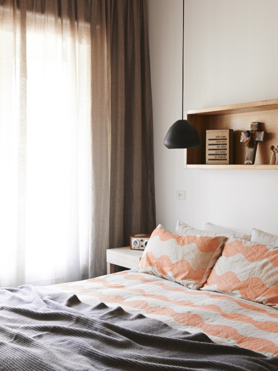 Bedroom with peach sheets