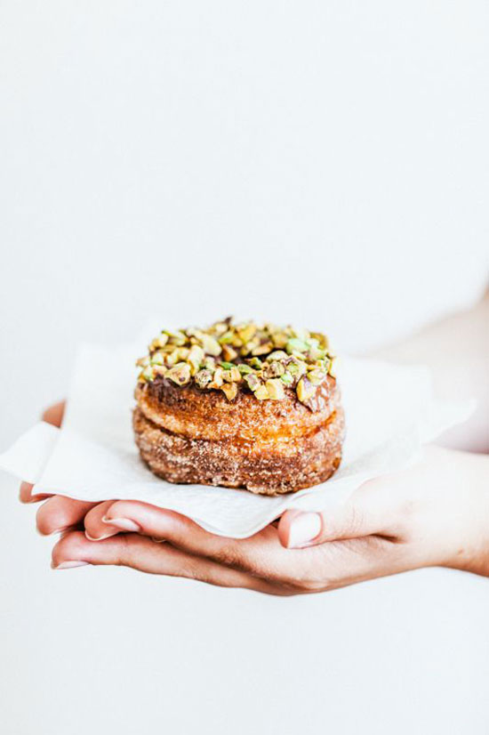 Cronut topped with pistachios