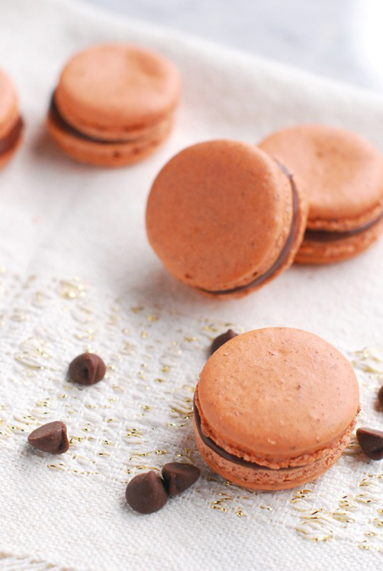 Pumpkin macarons with chocolate ganache from The Proper Pinwheel