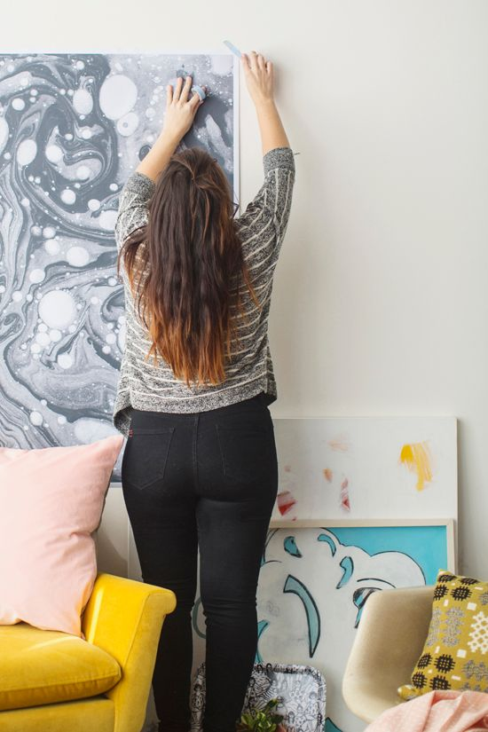 Hang artwork with washi tape to avoid putting holes in the wall.