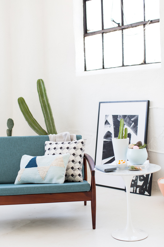 All white loft space with mid century loveseat