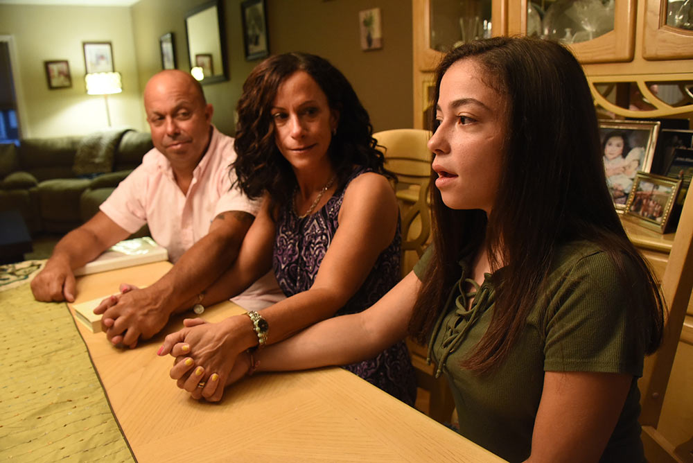 Linda and Greg McLehose and their daughter Casey spoke to Newsday at their Bayport home, August 28, 2018. Linda went into labor on 9/10/01 and was medicated through most of the night. She remembers coming to the next morning, right after the second plane hit. Their daughter, Casey, now 17, was born later that night.