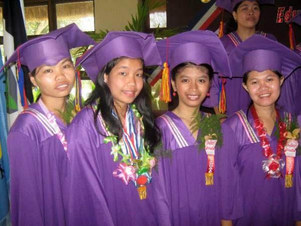4-female-grads-with-grins.jpg