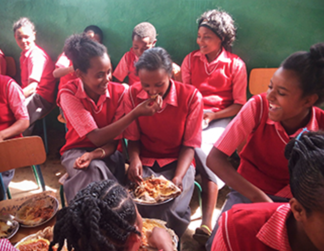 Precious food at Adams Thermal Academy Ottoro in Ethiopia. The children are not playing with their food as it appears. Rather, in Ethiopian culture, it is an act of love to feed another person and to share what you have.
