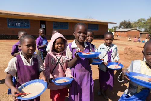 VillagePartnership_FeedingChildren.jpg