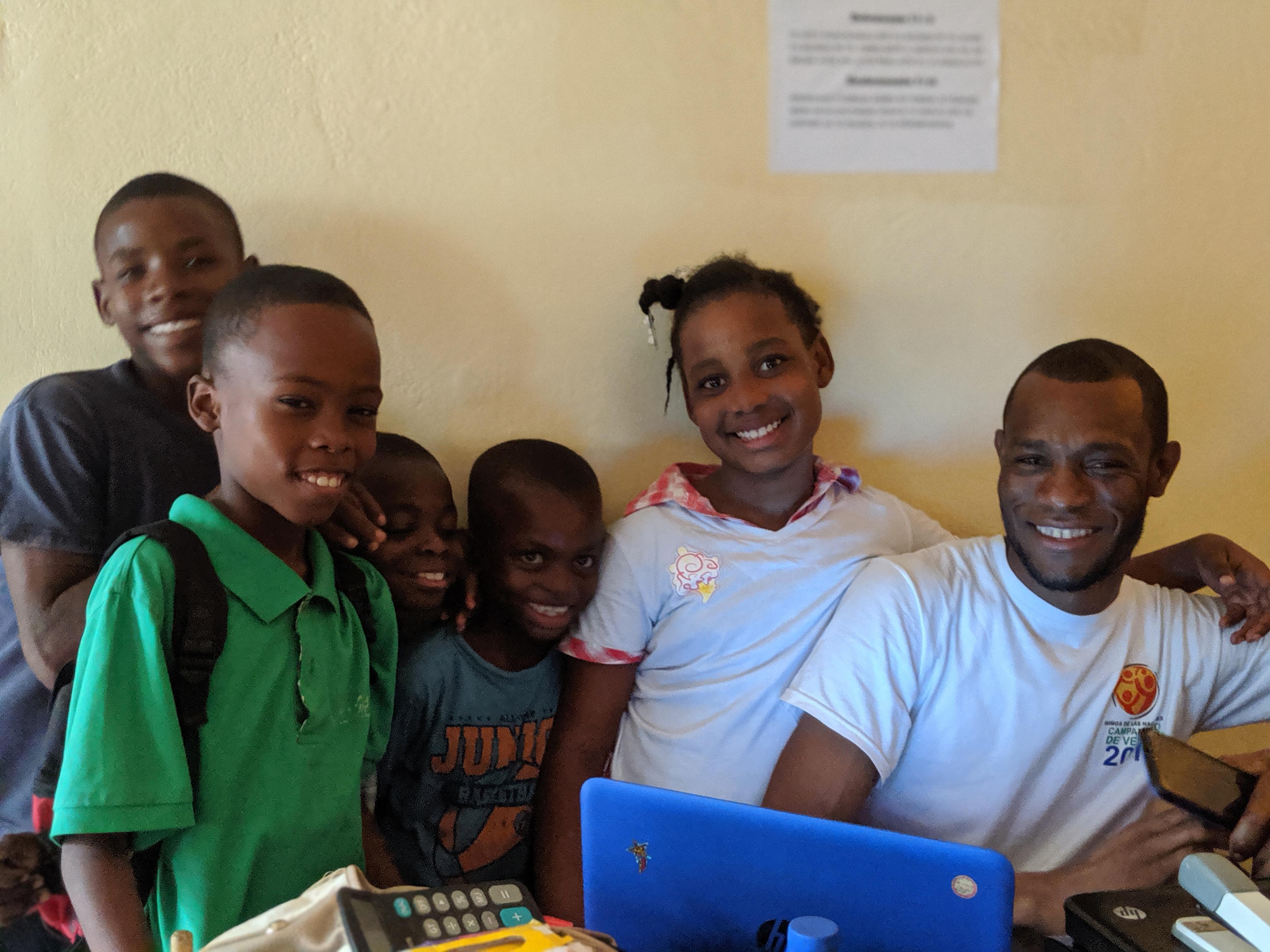Ernesto with children in the afterschool program.