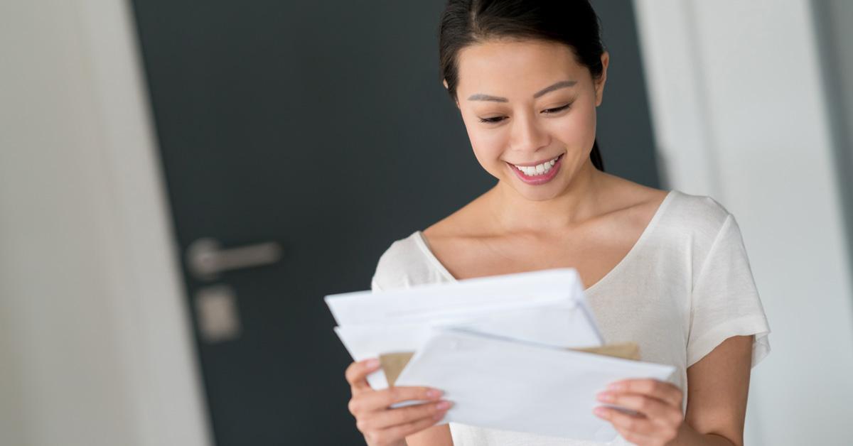 Woman Sorting Through Mail