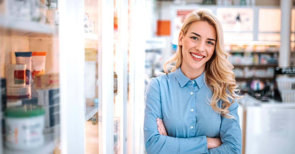 Happy woman standing in shop