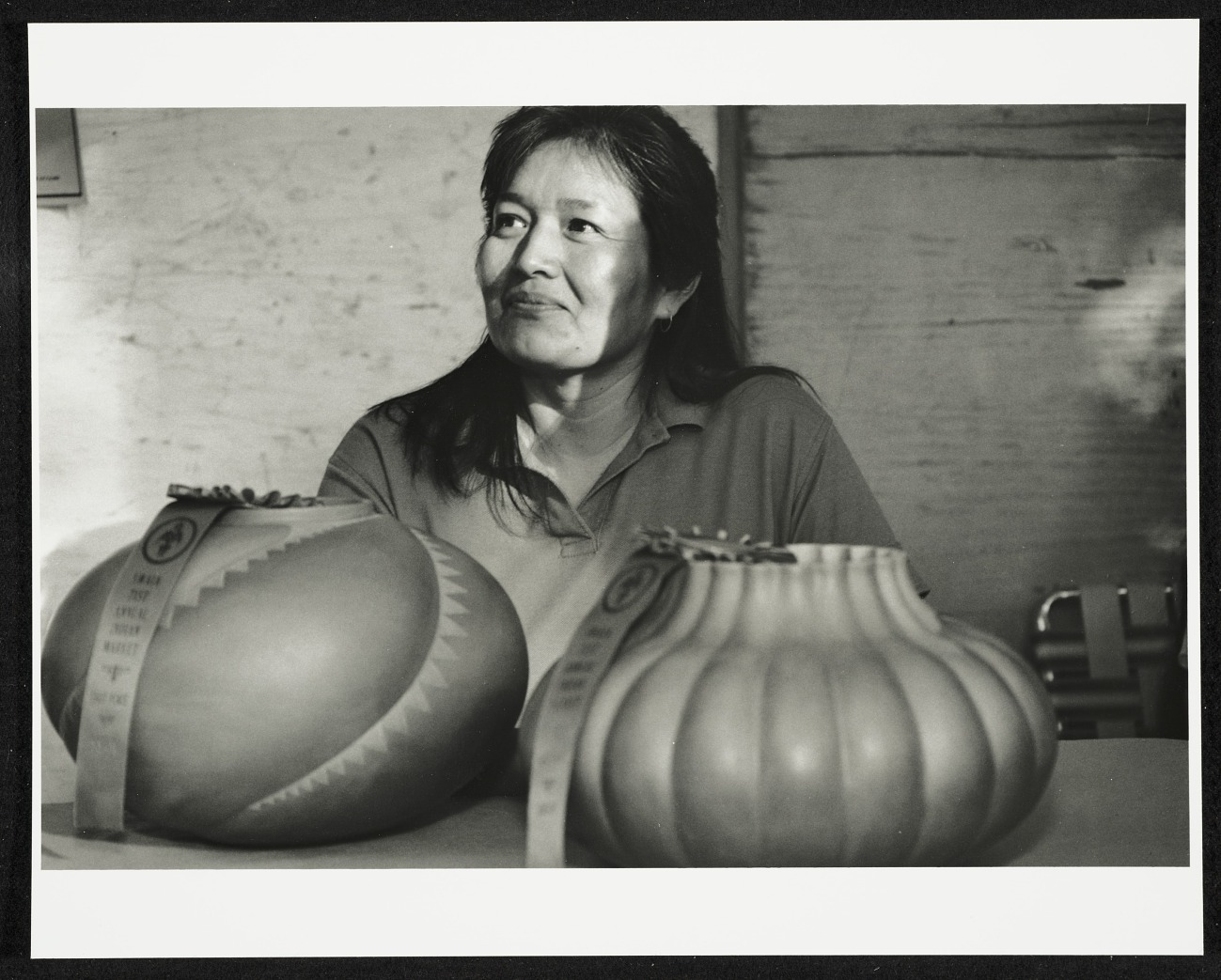 The Navajo artist with two of her pots