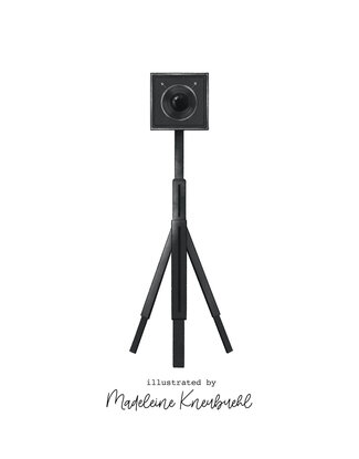 """The last page shows a black camera on a white background. It sits on a tripod, and the camera's large lens looking straight at us. Text reads, """"Illustrated by Madeline  Kneubheul."""""""