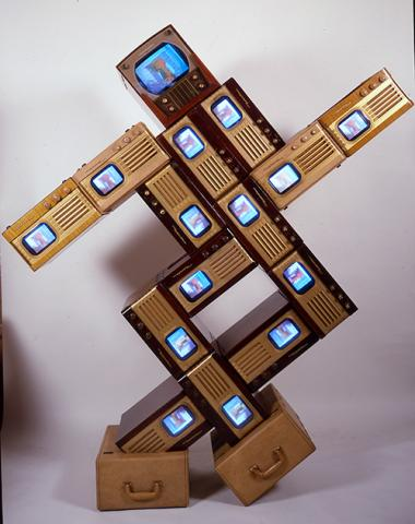 Name June Paik's Merce/Digital made from vintage television cabinets and fifteen monitors.