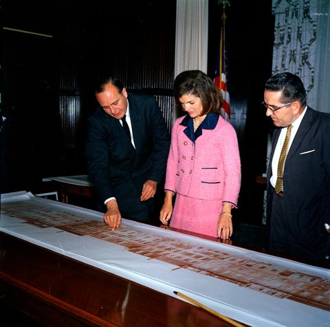 Jackie Kennedy looking at architectural drawings