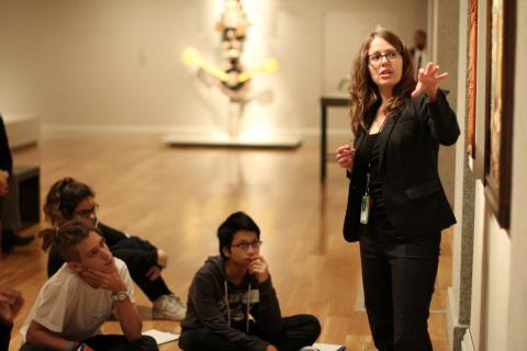 Museum educator speaking to students