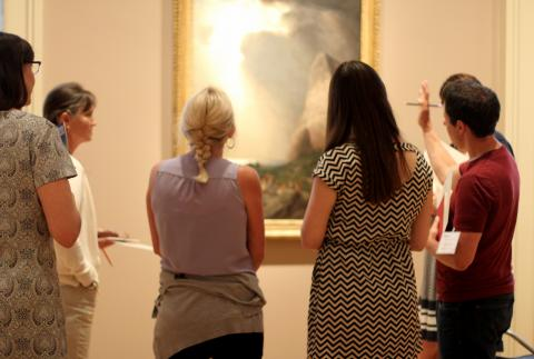 A photo of five individuals having a discussion in the gallery during Teachers Institute.