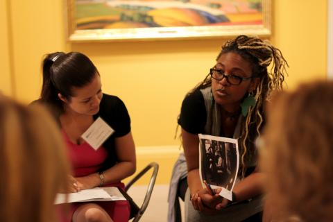 A photo of two women in a group discussion during Teachers Institute.