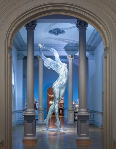 An image of a sculpture piece of a woman stretching her arms out inside the Renwick Gallery.