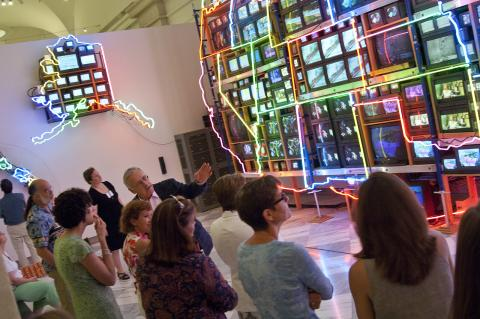 This is a docent tour in front of Nam June Paik's Superhighway at the Smithsonian American Art Museum.