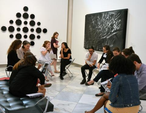 Teachers discuss artwork in gallery at the Smithsonian American Art Museum.