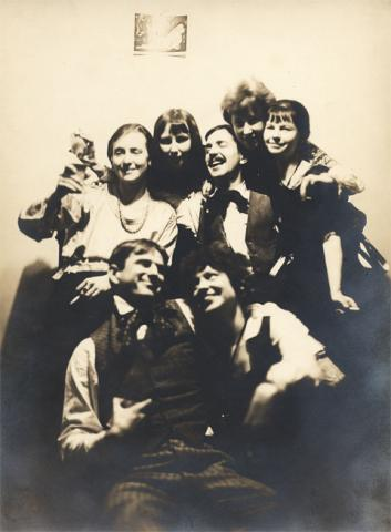 A photo of seven people laughing and smiling.