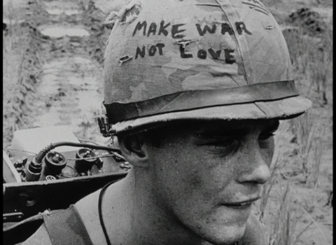 The face of soldier with a helmet that says