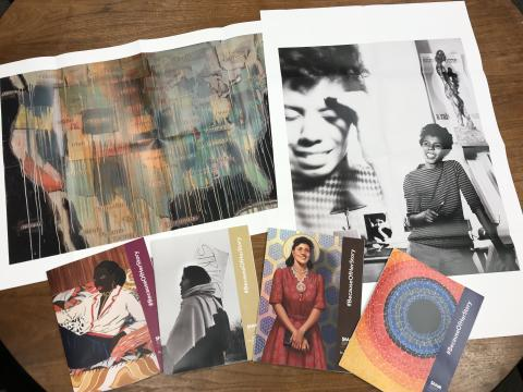 A photograph of six different artworks on postcards.