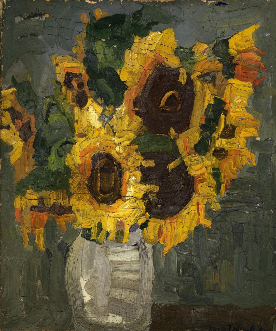 A still life of sunflowers in a translucent white vase