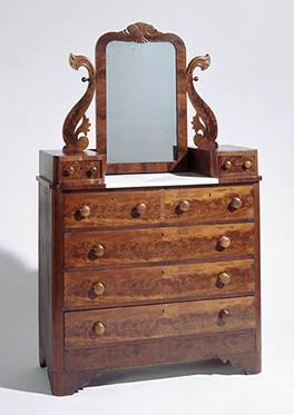 A bureau made of mahogany, yellow pine, and poplar
