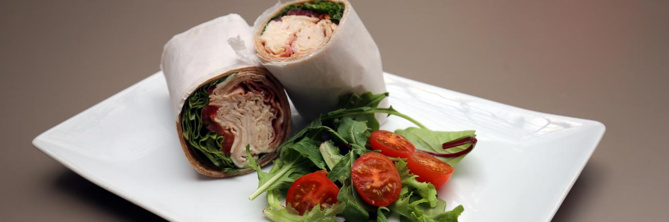 This is an image of a turkey wrap with a salad from the Courtyard Cafe at the Smithsonian American Art Museum.
