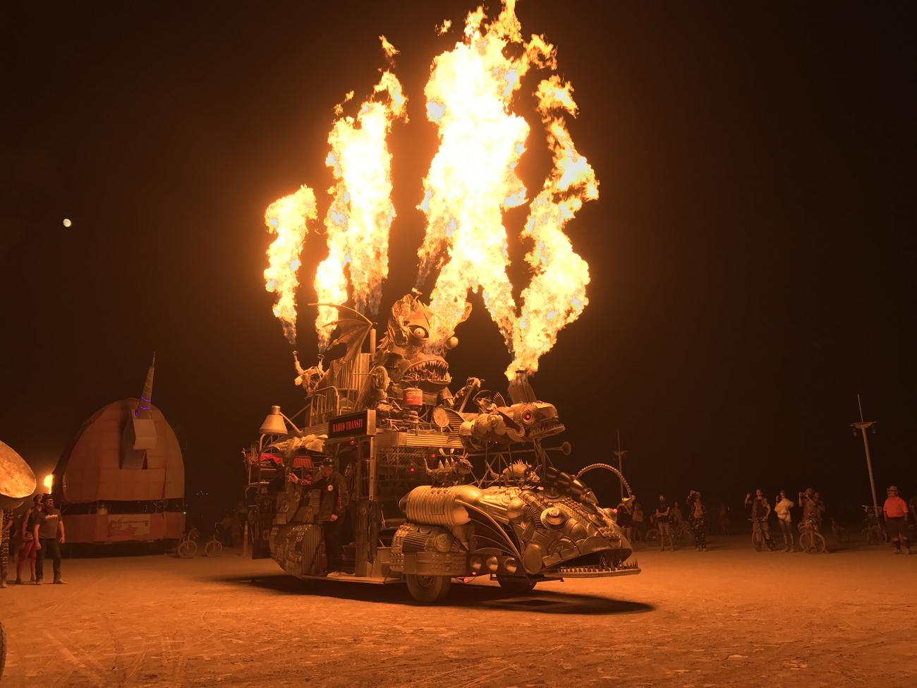 A picture of Burning Man, 2017, with an art object shooting flames.