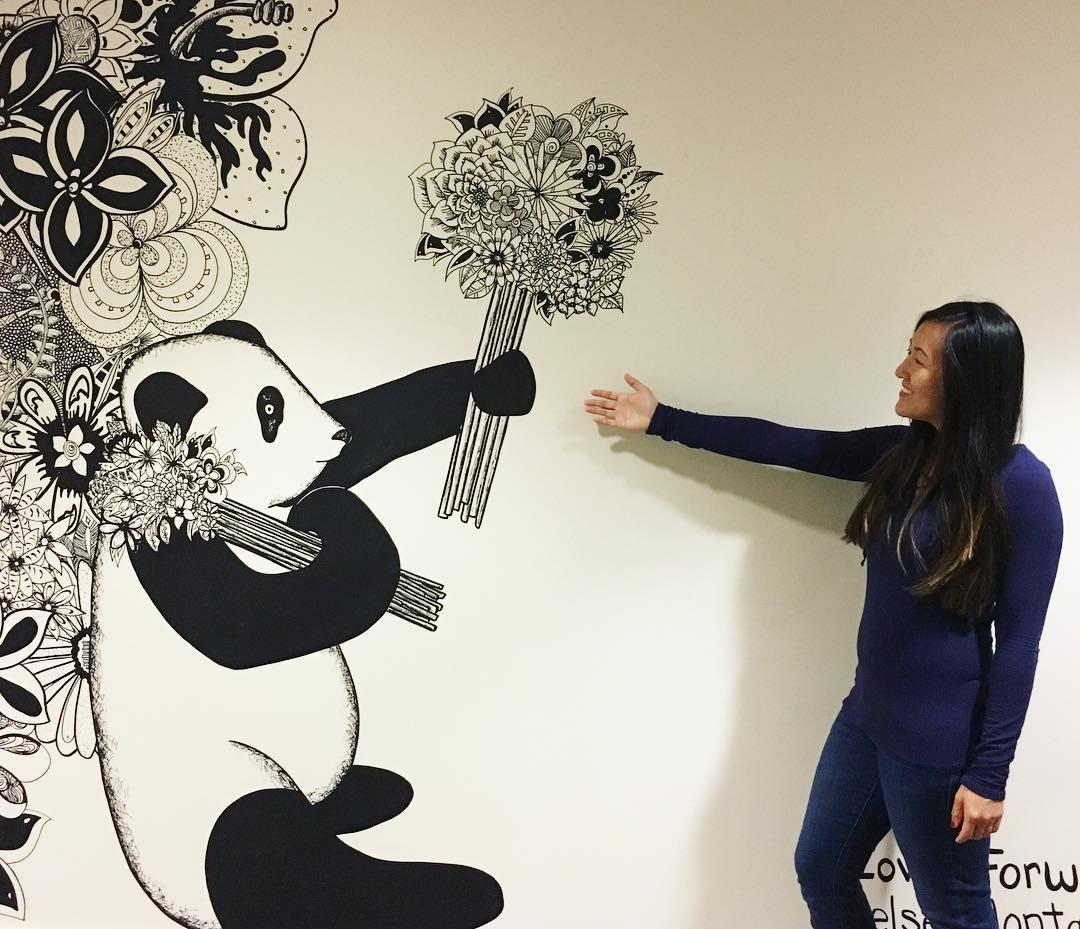woman posing with panda wall mural
