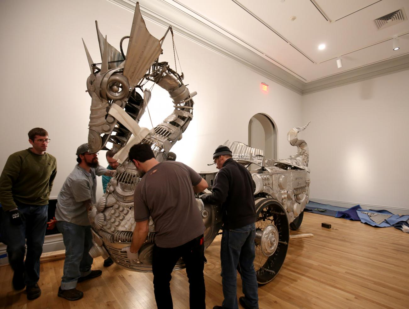 The museum team and artist working to assemble the dragon