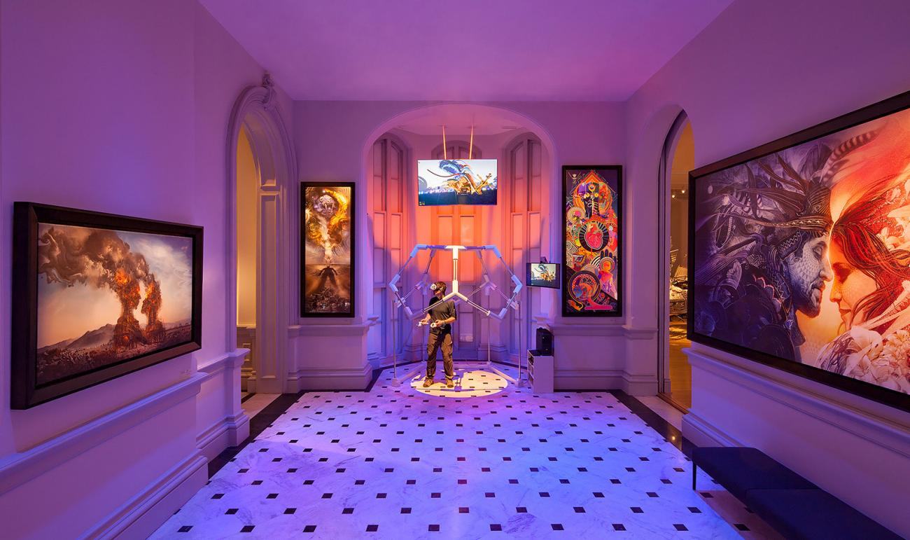 A picture of a gallery view with paintings on the wall and a VR station in the middle.