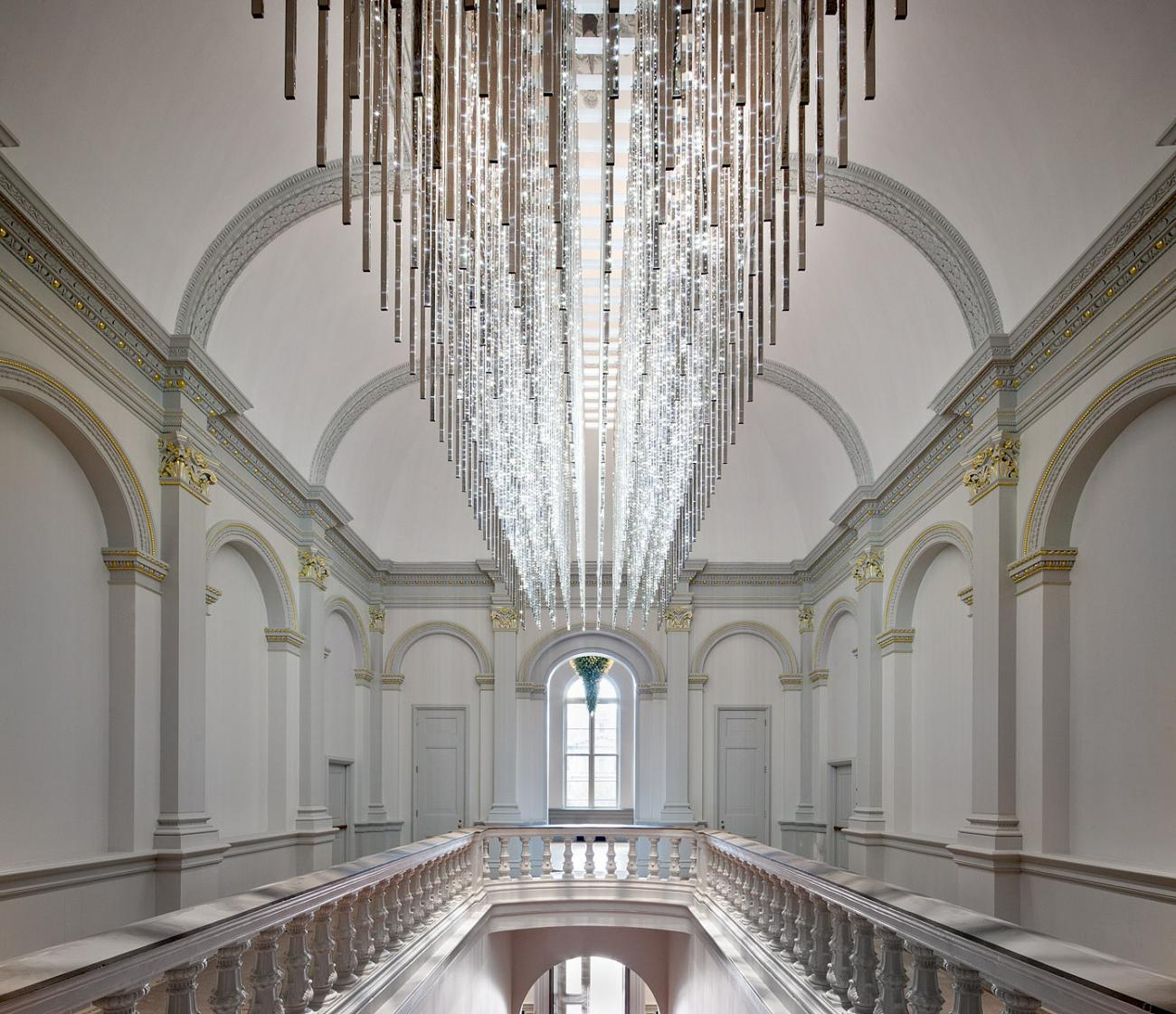 an image of the staircase with a grand LED chandelier at the Renwick Gallery.
