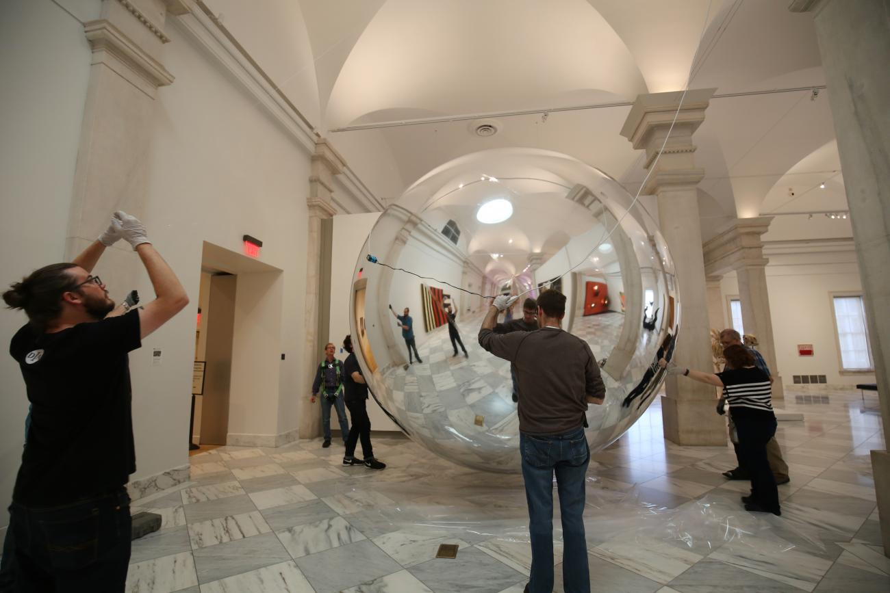 Installing the artist's Prototype for a Satellite in the exhibition Trevor Paglen: Sites Unseen