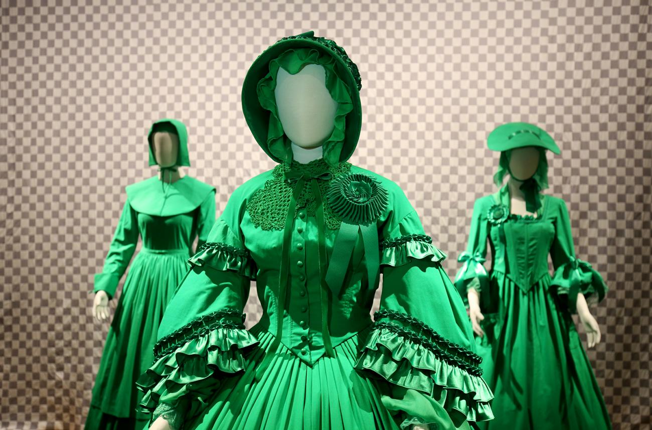 A photograph of three green chroma-key dresses.